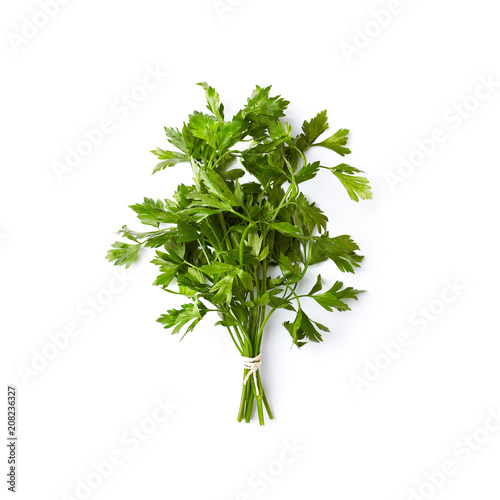 Bunch of fresh organic parsley leaves on white background