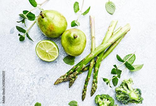 An Arrangement of Green Vegetables, Fruits and Herbs; flatlay