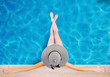 Leinwanddruck Bild - Girl with hat at the swimming pool. Concept of summer relax