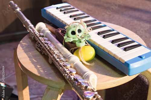wind instrumental keyboard next to the trumpet and skull - 208236984