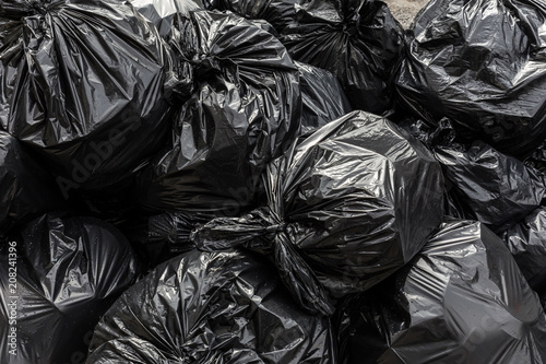Leinwanddruck Bild Background garbage bag black bin waste, Garbage dump, Bin,Trash, Garbage, Rubbish, Plastic Bags pile junk garbage Trash texture, Background waste plastic bin bag.