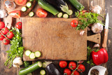 wooden board with raw vegetables - 208243115