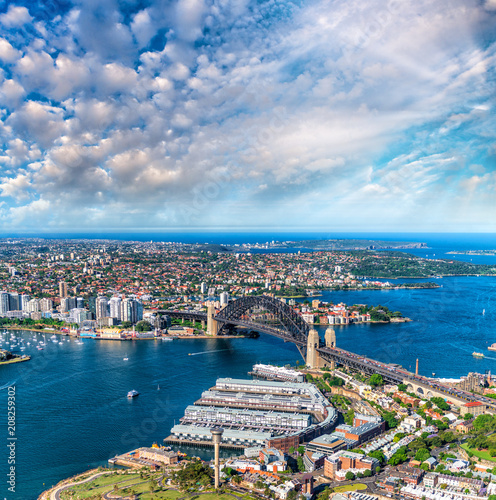 Fotobehang Sydney Helicopter view of Sydney Harbor Bridge and city skyline, Australia