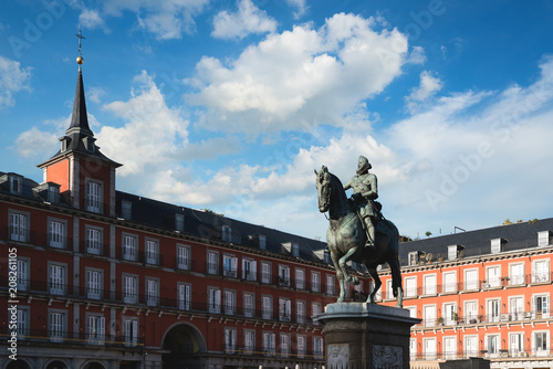 Madrid travel destination. Statue of Philip III on Plaza Mayor. Historical building in Plaza Mayor area at Madrid, Spain.