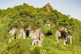 Caves on the mountain side in Vietnam. - 208262515