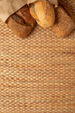 Various kind of bread put together on weave grass background with copy space. - 208264535