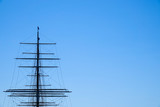 Large mast and guy wire of an old sailing ship. Copy space for text. - 208271110