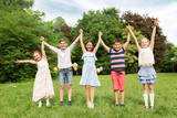 holidays, childhood and celebration concept - happy kids having fun on birthday party at summer park - 208275935