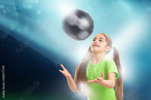 Aluminium Voetbal Cheerful little girl plays with soccer ball