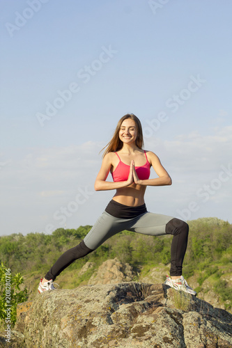 Fotobehang School de yoga Young beautiful woman doing peacefully yoga outdoors