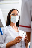 A young female dentist preparing for a Procedure