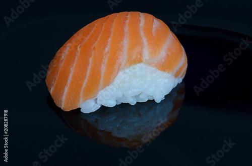 Aluminium Sushi bar Sushi salmon on black background. Minimalist Japanese food concept. Copy space.