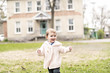 Leinwanddruck Bild - Smiling little girl outside wearing in pink