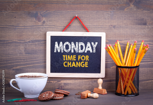 Monday time for change. Business Concept. Chalkboard on a wooden background.