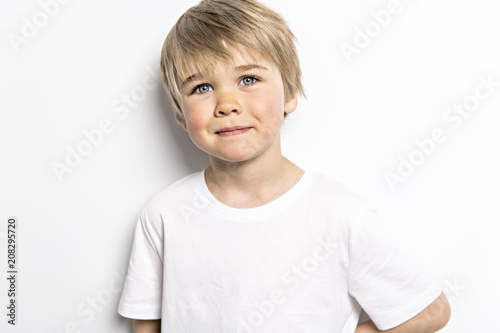 cute five year old boy studio portrait on white background