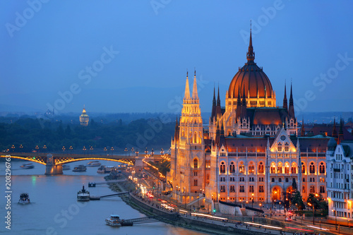 Fotobehang Boedapest Hungarian Parliament in Budapest by the Danube river in sunset light
