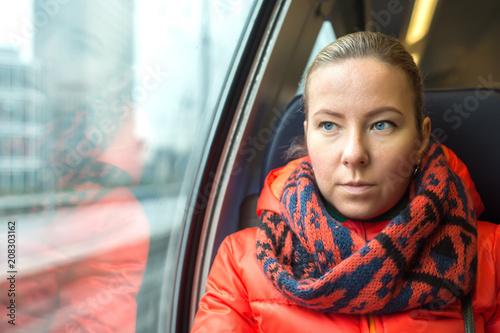 Fototapeta Woman traveling by train