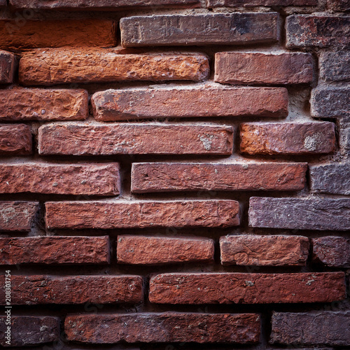 The texture of an old brick wall. - 208303754