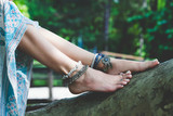 woman summer boho fashion style details on barefoot anklets and rings outdoor - 208305945