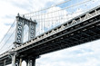 Closeup isolated against sky view of under Manhattan Bridge in Brooklyn outside exterior outdoors in NYC New York City