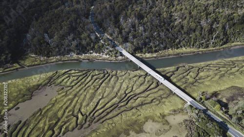 Fotobehang Grijze traf. River Patterns and Bridge, Tasmanian Landscape Australia Views from the air