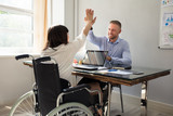 Disabled Businesswoman Giving High Five To Her Partner - 208323316