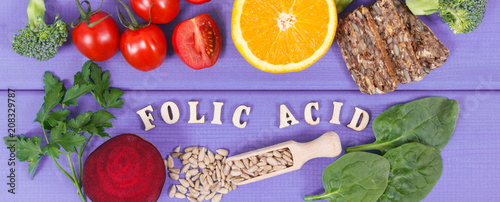 Inscription folic acid with nutritious products containing vitamin B9 and dietary fiber, healthy nutrition concept