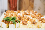 pieces of cheese with walnuts and honey - 208332734