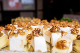 pieces of cheese with walnuts and honey - 208332741