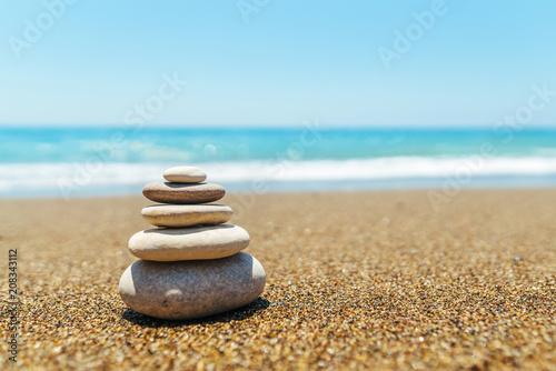 Fotobehang Zen Stenen Stack of stones on the beach near sea