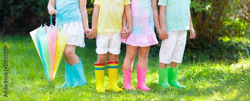 Leinwanddruck Bild Kids in rain boots. Rubber boots for children.