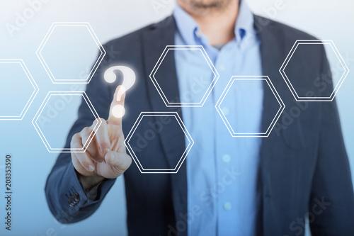Leinwanddruck Bild Businessman Finger Touch Hexagons Question Mark