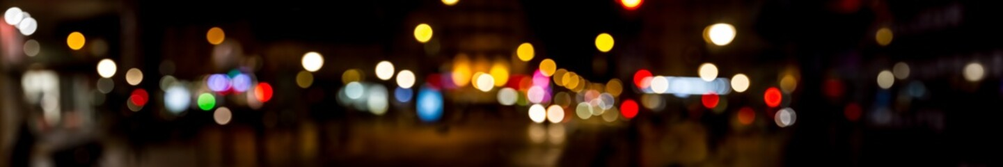 Bokeh traffic light at night in the street of a big city © sdecoret