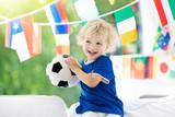 Kids watch football game. Child watching soccer. - 208357153