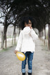 Girl blowing balloon outside