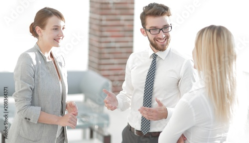 Manager and business team talking in the office.