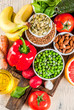 Healthy food background, trendy Alkaline diet products - fruits, vegetables, cereals, nuts. oils, light concrete background  copy space top close view