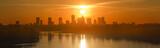Panorama Warszawy na tle zachodzącego słońca - 208370139