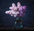 Still life bouquet lilac in a glass vase