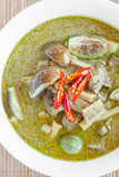 Green chicken curry with eggplant and pickled bamboo shoot. Green curry is a Central Thai variety of curry - 208371395