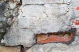 Damaged dirty old brick wall is close - 208374921