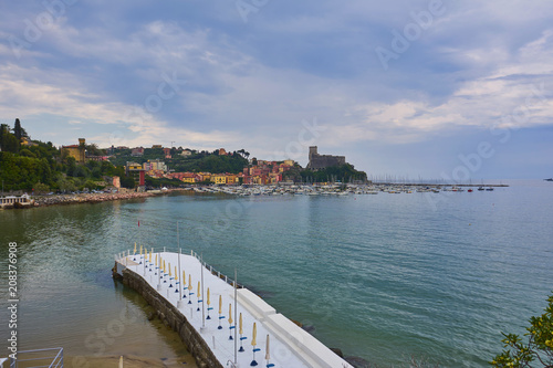 Aluminium Liguria Colorful Houses and Seascape with Old castle and Blue Cloudy Sky