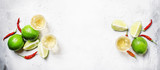 Gold mexican tequila with lime and salt, white drink background, top view