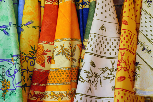 Colorful tablecloth with traditional Provencal fabrics with olive branches © eqroy