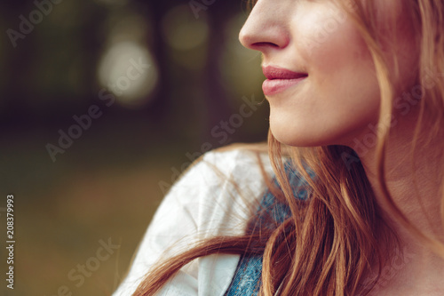 Leinwanddruck Bild Outdoors portrait of beautiful young girl