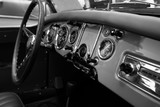 ISRAEL, PETAH TIQWA - MAY 14, 2016:  Exhibition of technical antiques. Steering wheel and dashboard in interior of old retro automobile in Petah Tiqwa, Israel