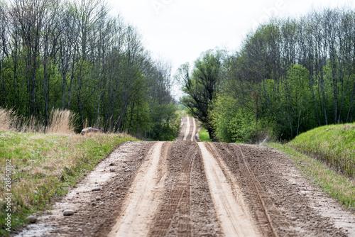 Aluminium Donkergrijs empty gravel road in the countryside in summer heat