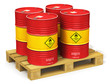 Leinwanddruck Bild - Group of red oil drums on shipping pallet isolated on white