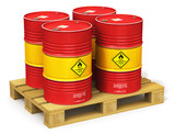 Group of red oil drums on shipping pallet isolated on white
