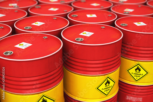 Leinwanddruck Bild Group of rows of red stacked oil drums in storage warehouse
